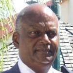 Minister van Justitie Dennis Richardson - foto:  Milton Pieters