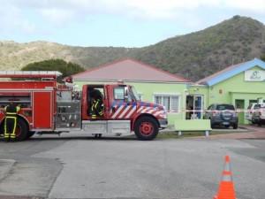 Een brandweerwagen bij het Eutel kantoor -foto: The Daily Herald/Althea Merkman